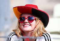 A Germany supporter smiles in the stands