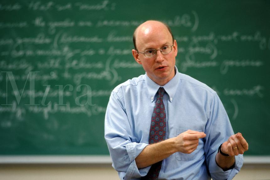 College professor teaching class in philosophy / ethics.