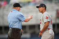 Johnson City Cardinals manager Roberto Espinoza (41) talks with home plate umpire Zachary Robbins during the second game of a doubleheader against the Princeton Rays on August 17, 2018 at Hunnicutt Field in Princeton, Virginia.  Princeton defeated Johnson City 12-1.  (Mike Janes/Four Seam Images)