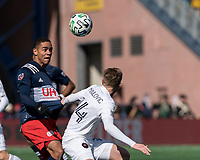 FOXBOROUGH, MA - MARCH 7: Brandon Bye #15 of New England Revolution heads the ball during a game between Chicago Fire and New England Revolution at Gillette Stadium on March 7, 2020 in Foxborough, Massachusetts.