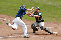 September 2, 2006:  New York Mets International Singing Kai Gronauer tags out a runner while playing amateur baseball in Germany.  Gronauer, a catcher, signed with the Mets in 2008.  Photo By Gregor Eisenhuth/Four Seam Images