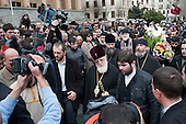 Catholicos Patriarch Ilia II, head of the Eastern Orthodox Church in Georgia, attends a memorial rally on the anniversary of the 1989 Soviet massacre of 20 hunger strikers outside the Parliament building in Tbilisi, Georgia.
