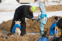 Melissa Owens signs an autograph at the Shageluk checkpoint during Iditarod 2009