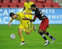 WASHINGTON, DC - OCTOBER 28: Krisztian Nemeth #29 of Columbus Crew SC battles for the ball with Donovan Pines #23 of D.C. United during a game between Columbus Crew and D.C. United at Audi Field on October 28, 2020 in Washington, DC.