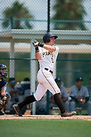 GCL Pirates third baseman Patrick Dorrian (50) follows through on a swing during a game against the GCL Tigers West on August 13, 2018 at Pirate City Complex in Bradenton, Florida.  GCL Tigers West defeated GCL Pirates 5-1.  (Mike Janes/Four Seam Images)