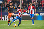 Jorge Resurreccion Merodio, Koke, of Atletico de Madrid  (center) competes for the ball with Daniel Parejo Munoz of Valencia CF (left) during the match Atletico de Madrid vs Valencia CF, a La Liga match at the Estadio Vicente Calderon on 05 March 2017 in Madrid, Spain. Photo by Diego Gonzalez Souto / Power Sport Images