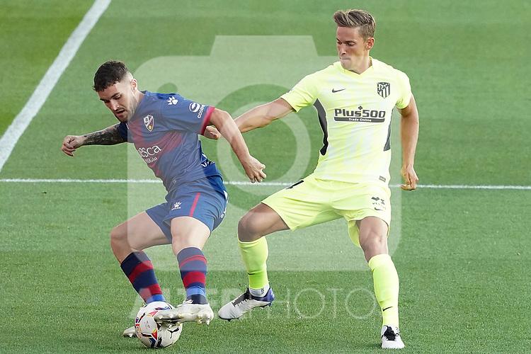 SD Huesca's Javi Galan (l) and Atletico de Madrid's Marcos Llorente during La Liga match. September 30,2020. (ALTERPHOTOS/Acero)