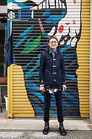 MAY 15, 2014 - KOJIMA, KURASHIKI, JAPAN: A shop owner pose in front of a shop at Jeans Street.  (Photograph / Ko Sasaki)