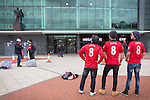 © Joel Goodman - 07973 332324 . 27/01/2014 . Manchester , UK . Thai tourists L-R Suthon Apinuntavach (50) , Putthipong W (35) and Soradetch Phetsangsailkul (35) (all correct) pose with their new shirts , mirroring the United Trilogy statue . Their in Manchester to watch the Cardiff game tomorrow . Fans with new MATA 8 shirts in front of Old Trafford Football Ground as it's announced that Spaniard Juan Mata ( Juan Manuel Mata García ) has signed for Manchester United  . Photo credit : Joel Goodman