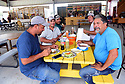 Diners enjoy the different food offerings at the Westbank Nawlins Flea Market.