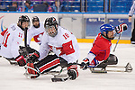 Sochi, RUSSIA - Mar 11 2014 -  Billy Bridges controls the puck as Canada takes on Czech Republic in Sledge Hockey at the 2014 Paralympic Winter Games in Sochi, Russia.  (Photo: Matthew Murnaghan/Canadian Paralympic Committee)