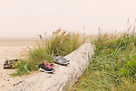 Shoes on beach at Lost Creek State Recreation Site, U.S. Highway 101, Pacific Coast Scenic Byway, near Newport, Oregon.  Oregon Central Coast, beaches, bays, bars, family fun, winter storms, lighthouses, fishing boats, bluffs, fossils and beach walks.
