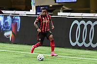 ATLANTA, GA - AUGUST 29: George Bello #21 of Atlanta United dribbles the ball during a game between Orlando City SC and Atlanta United FC at Marecedes-Benz Stadium on August 29, 2020 in Atlanta, Georgia.