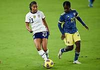 ORLANDO, FL - JANUARY 18: Margaret Purce #23 of the United States passes off the ball during a game between Colombia and USWNT at Exploria Stadium on January 18, 2021 in Orlando, Florida.