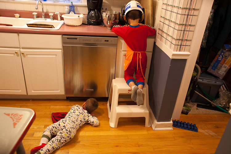 Both my sons like to help me bake. Here my two-year-old assists by peering under the dishwasher, and my five-year-old zests a lemon with a police helmet protecting his eyes from the juice.