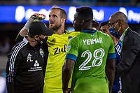 SAN JOSE, CA - MAY 12: Stefan Frei #24 of the Seattle Sounders is assisted off the field during a game between San Jose Earthquakes and Seattle Sounders FC at PayPal Park on May 12, 2021 in San Jose, California.