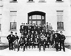 """GGPN 15/05:  A group of Sorin Hall residents posed on the front steps of Sorin Hall, c1890s.  Colonel William Hoynes is in the center with a top hat..Caption:  """"Sorinites - 1890s.""""  Image from the University of Notre Dame Archives."""
