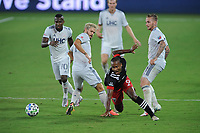 WASHINGTON, DC - AUGUST 25: Ola Kamara #9 of D.C. United battles for the ball with Kelyn Rowe #11 and Alexander Buttner #28 of New England Revolution during a game between New England Revolution and D.C. United at Audi Field on August 25, 2020 in Washington, DC.