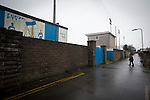 Port Talbot Town 3 Caerau Ely 0, 06/02/2016. Genquip Stadium, Welsh Cup fourth round. A solitary spectator makes his way towards the turnstiles before Port Talbot Town played host to Caerau Ely in a Welsh Cup fourth round tie at the Genquip Stadium, formerly known as Victoria Road. Formed by exiled Scots in 1901 as Port Talbot Athletic, they competed in local and regional football before being promoted to the League of Wales  in 2000 and changing their name to the current version a year later. Town won this tie 3-0 against their opponents from the Welsh League, one level below the welsh Premier League where Port Talbot competed, watched by a crowd of 113. Photo by Colin McPherson.