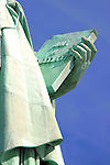 Close up view of stone tablet held by Statue of Liberty commemorating the American Declaration of Independence.