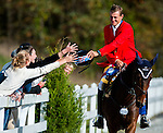 Boyd Martin reaches out to high-five young fans during his victory lap aboard Ying Yang Yo at the Dansko Fair Hill International 3-Day Event in Fair Hill, Maryland on October 16, 2011. Martin's round secured his second win in three years at Fair Hill.