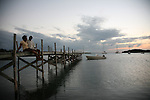 Couple on pier at Great Guana, Abacos, at sunset