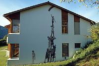 Murales su di un muro di una casa Svizzera.Murals on a wall of a house in Switzerland...