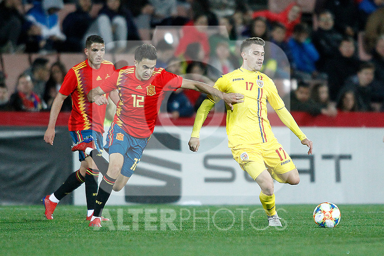 Spain's Sergio Reguilon and Romania's Olaru Darius  during the International Friendly match on 21th March, 2019 in Granada, Spain. (ALTERPHOTOS/Alconada)