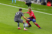 ST PAUL, MN - SEPTEMBER 9: Hassani Dotson #31 of Minnesota United FC and Michael Barrios #21 of FC Dallas battle for the ball during a game between FC Dallas and Minnesota United FC at Allianz Field on September 9, 2020 in St Paul, Minnesota.