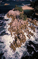 Aerial View of waves pounding the rugged coastline of Calvert Island. Central Coast of BC. Remote, wild, surf, shore, wave, danger, erosion, wilderness. British Columbia Canada Calvert Island.