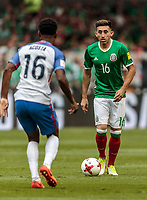Mexico City, Mexico - Sunday June 11, 2017: Kellyn Acosta, Héctor Herrera during a 2018 FIFA World Cup Qualifying Final Round match with both men's national teams of the United States (USA) and Mexico (MEX) playing to a 1-1 draw at Azteca Stadium.