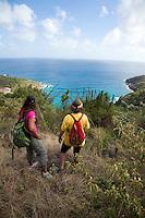 Hikers Janet Simonsen and Brooke Morton along the.Tektite trail near Lameshur Bay<br /> St John<br /> US Virgin Islands