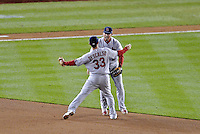 12 October 2012: The St. Louis Cardinals second baseman Daniel Descalso celebrates pulling in the final out of the game with first baseman Allen Craig to cap Postseason Playoff Game 5 of the National League Divisional Series against the Washington Nationals at Nationals Park in Washington, DC. The Cardinals stunned the home team Nats with a four-run rally in the 9th inning to defeat the Nationals 9-7 and win the NLDS, moving on to the NL Championship Series. Mandatory Credit: Ed Wolfstein Photo