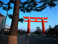 "The first outer, gateway (""torii"") to the Heian Shrine, Kyoto, Japan, framed by a typical Japanese pine-tree, early mornin"