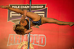A participant takes part in a pole dancing competition during the Arnold Classic Asia Multi-Sport Festival in Hong Kong on 20 August 2016 at the AsiaWorld-Expo, Hong Kong. Photo by Marcio Machado / Power Sport Images