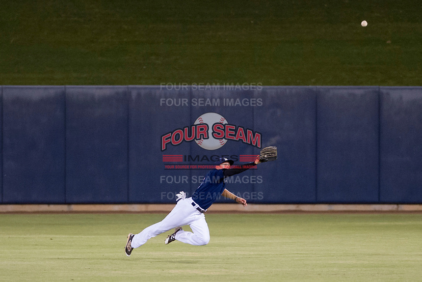 AZL Brewers center fielder Jesus Lujano (26) attempts a diving catch as right fielder Robert Henry (49) looks on against the AZL Cubs on August 24, 2017 at Maryvale Baseball Park in Phoenix, Arizona. AZL Cubs defeated the AZL Brewers 9-1. (Zachary Lucy/Four Seam Images)