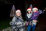 Ann O'Mahoney, Laoise Neary and Fiona O'Mahoney admiring the Christmas tree lights   in Ardfert on Sunday.