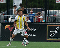HARTFORD, CT - AUGUST 17: AJ Paterson #20 of Charleston Battery looks to pass during a game between Charleston Battery and Hartford Athletic at Dillon Stadium on August 17, 2021 in Hartford, Connecticut.
