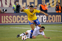 Alejandro Bedoya (11) of the United States attempts to slow Andre Santos (6) of Brazil. The men's national team of Brazil (BRA) defeated the United States (USA) 2-0 during an international friendly at the New Meadowlands Stadium in East Rutherford, NJ, on August 10, 2010.