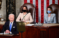US President Joe Biden addresses a joint session of Congress as US Vice President Kamala Harris (C) and Speaker of the United States House of Representatives Nancy Pelosi (D-CA) look on at the US Capitol in Washington, DC, on April 28, 2021. <br /> CAP/MPI/RS<br /> ©RS/MPI/Capital Pictures