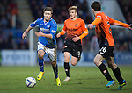 St Johnstone v Dundee United.....29.12.13   SPFL<br /> Gwion Edwards takes on Andrew Robertson<br /> Picture by Graeme Hart.<br /> Copyright Perthshire Picture Agency<br /> Tel: 01738 623350  Mobile: 07990 594431