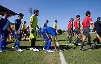 Guatemala captain Gerardo Gordillo touches the grass as he enters the field during the group stage of the CONCACAF Men's Under 17 Championship at Catherine Hall Stadium in Montego Bay, Jamaica. Jamaica defeated Guatemala, 1-0.