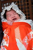Japan, Okayama Prefecture, Kurashiki. Baby at Tsuru gata yama park. Bride and groom.