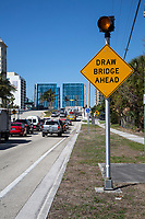 Ft. Lauderdale, Florida.  Traffic Waits While East Sunrise Boulevard Drawbridge is Up for a Boat Passing on the Intracoastal waterway.