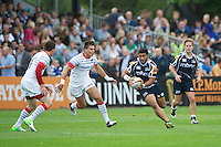 20120803 Copyright onEdition 2012©.Free for editorial use image, please credit: onEdition..Will Hafu of Sale Sharks looks to go around Nils Mordt (centre) and Ben Spencer of Saracens at The Recreation Ground, Bath in the Final round of The J.P. Morgan Asset Management Premiership Rugby 7s Series...The J.P. Morgan Asset Management Premiership Rugby 7s Series kicked off again for the third season on Friday 13th July at The Stoop, Twickenham with Pool B being played at Edgeley Park, Stockport on Friday, 20th July, Pool C at Kingsholm Gloucester on Thursday, 26th July and the Final being played at The Recreation Ground, Bath on Friday 3rd August. The innovative tournament, which involves all 12 Premiership Rugby clubs, offers a fantastic platform for some of the country's finest young athletes to be exposed to the excitement, pressures and skills required to compete at an elite level...The 12 Premiership Rugby clubs are divided into three groups for the tournament, with the winner and runner up of each regional event going through to the Final. There are six games each evening, with each match consisting of two 7 minute halves with a 2 minute break at half time...For additional images please go to: http://www.w-w-i.com/jp_morgan_premiership_sevens/..For press contacts contact: Beth Begg at brandRapport on D: +44 (0)20 7932 5813 M: +44 (0)7900 88231 E: BBegg@brand-rapport.com..If you require a higher resolution image or you have any other onEdition photographic enquiries, please contact onEdition on 0845 900 2 900 or email info@onEdition.com.This image is copyright the onEdition 2012©..This image has been supplied by onEdition and must be credited onEdition. The author is asserting his full Moral rights in relation to the publication of this image. Rights for onward transmission of any image or file is not granted or implied. Changing or deleting Copyright information is illegal as specified in the Copyright, Design and Patents Act 1988. If you are in any way unsure of y