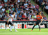 Sheffield United's Lee Evans vies for possession with Swansea City's Bersant Celina during the Sky Bet Championship match between Sheffield United and Swansea City at Bramall Lane, Sheffield, England, UK. Saturday 04 August 2018