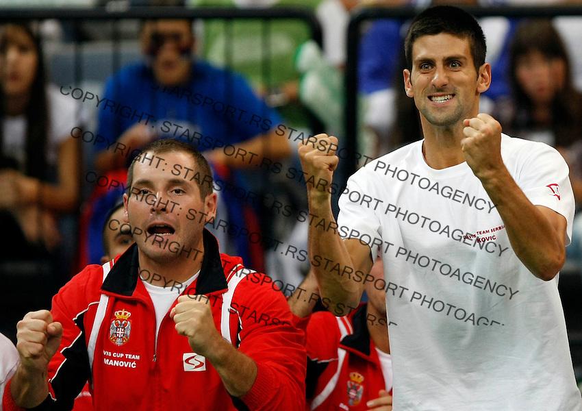 Tenis, Davis Cup 2010.Serbia Vs. Czech Republic, semifinals.Janko Tipsarevic Vs. Tomas Berdych.Novak Djokovic, center and Miljan Amanovic, react.Beograd, 17.09.2010..foto: Srdjan Stevanovic/Starsportphoto ©