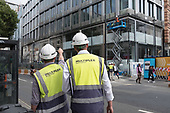 Workers employed by Australian contractor Multiplex at a construction site in Oxford Street, London.