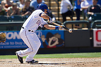 Round Rock second baseman Greg Miclat (2) lays down a bunt against the Nashville Sounds in the Pacific Coast League baseball game on May 5, 2013 at the Dell Diamond in Round Rock, Texas. Round Rock defeated Nashville 5-1. (Andrew Woolley/Four Seam Images).