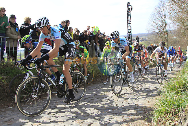 The peloton including team mates Stijn Vandenbergh and Tom Boonen (BEL) Omega Pharma-Quickstep climbs Koppenberg during the 96th edition of The Tour of Flanders 2012, running 256.9km from Bruges to Oudenaarde, Belgium. 1st April 2012. <br /> (Photo by Eoin Clarke/NEWSFILE).